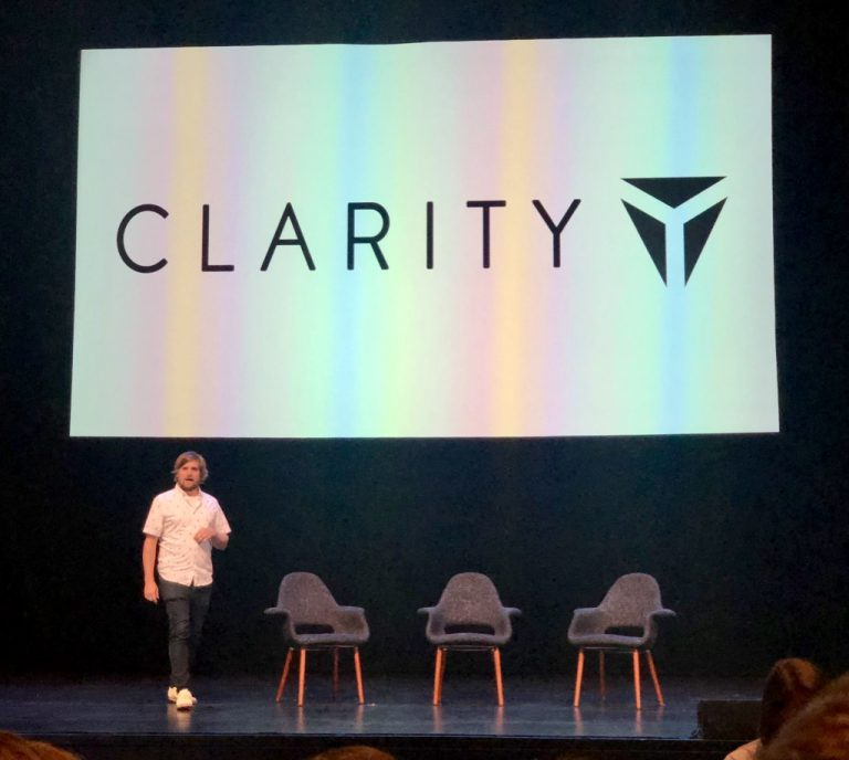 Emcee Brad Frost stands on stage at Clarity 2019