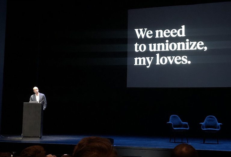 """""""We need to unionize, my loves."""" Ethan Marcotte stands on stage at Clarity 2019."""